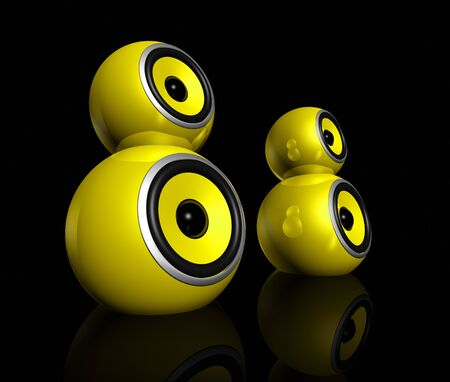 soundsystem: three dimensional yellow speaker spheres isolated on black Stock Photo