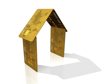 3D house made of credit cards - real estate symbol
