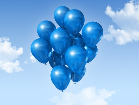 blue air balloons floating on a blue sky photo