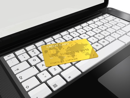 3D render of a gold credit card on a laptop Stock Photo - 9370830