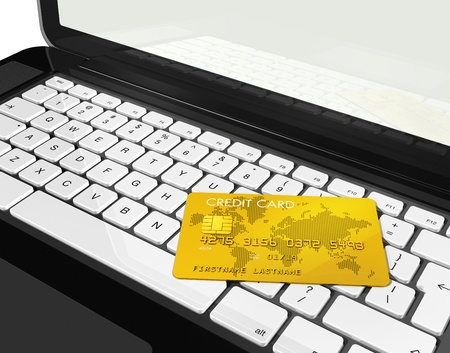3D render of a gold credit card on a laptop photo