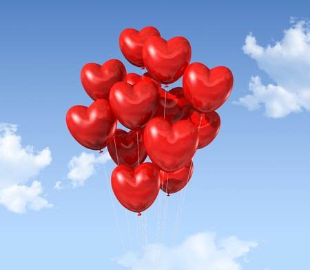 red heart shaped balloons floating in the sky. valentine Stock Photo