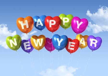 colored Happy new year heart shaped balloons floating in a blue sky