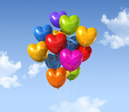 colored heart shape balloons floating on a blue sky photo