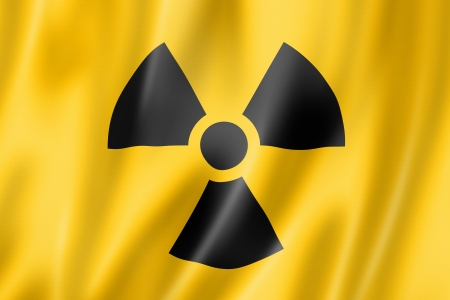 ionizing radiation risk: radioactive nuclear symbol flag, three dimensional render, satin texture