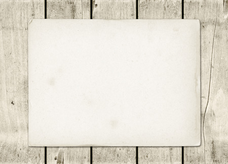 Blank vintage paper sheet on a white wood board panel