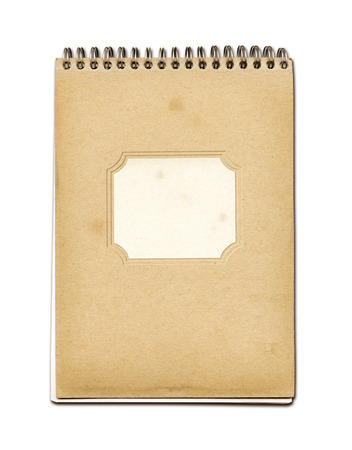 old notebook: Grunge spiral close notebook, brown paper cover, isolated on white Stock Photo