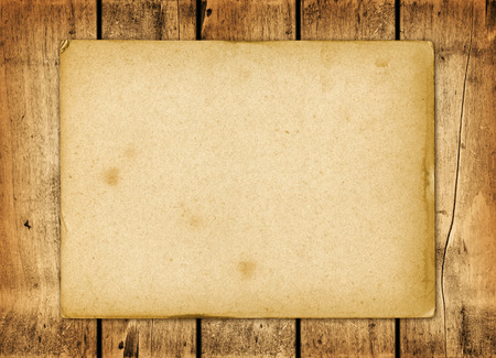 western wall: Blank vintage paper sheet on a wood board panel Stock Photo
