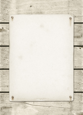 Blank vintage poster nailed on a white wood board panel Foto de archivo