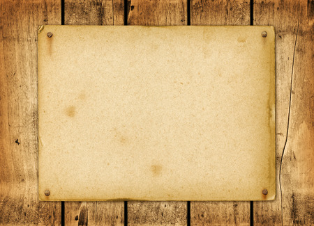 Blank vintage poster nailed on a wood board panel