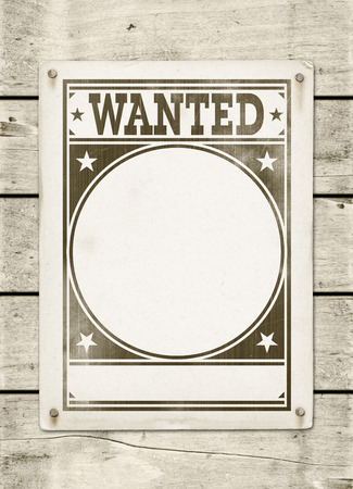 torn paper background: Wanted poster on a white wood board panel