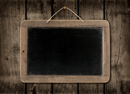 vintage timber: Blackboard on a old dark wood wall background texture Stock Photo