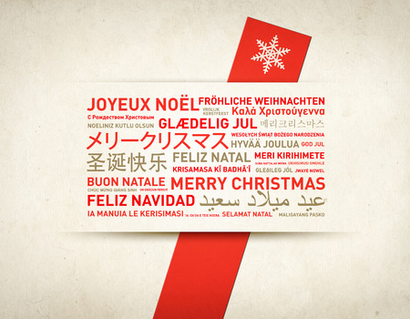written text: Merry christmas from the world. Different languages celebration retro card Stock Photo