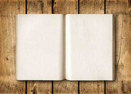 paper old: Open book on a brown wood table. Mockup Stock Photo