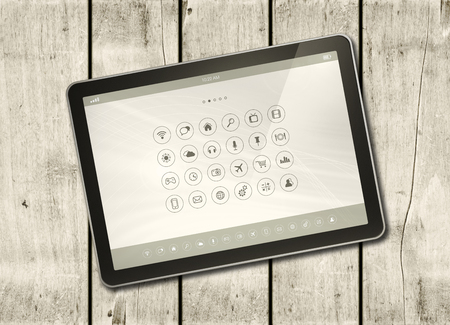 modern office: Digital tablet PC with desktop icons on a white wood table - horizontal office mockup
