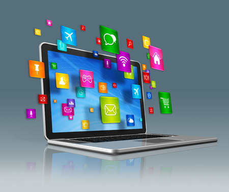 3D Laptop Computer with flying apps icons - isolated on a grey background Stock Photo