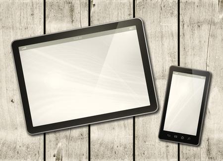 Smartphone e PC digitale della compressa su una tavola di legno bianca - modello orizzontale dell'ufficio Archivio Fotografico - 48053016