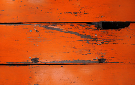 Old wood board painted red, background texture