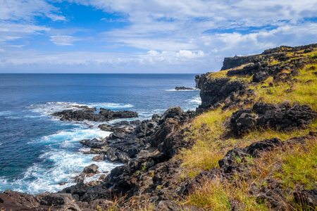Easter island cliffs and pacific ocean landscape, Chile Stock Photo