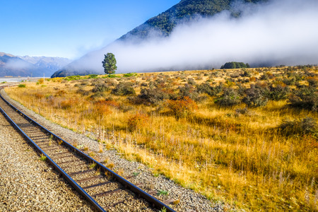 Railway in Mountain fields landscape, New Zealand alps Foto de archivo
