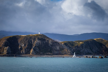 Lighthouse on cliffs near Wellington city, New Zealand Stock Photo