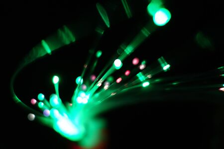 Colorful light explosion on black background. Futuristic wallpaper Фото со стока