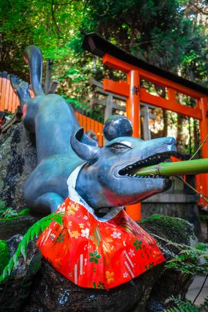 Fox purification fountain at Fushimi Inari Taisha torii shrine, Kyoto, Japan