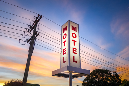 Vintage motel light sign at sunset, New Zealand Banco de Imagens