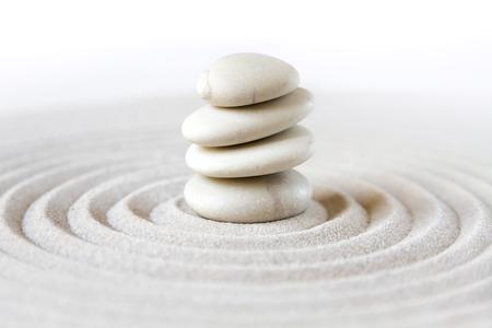White stones pile in the sand. Zen japanese garden background scene