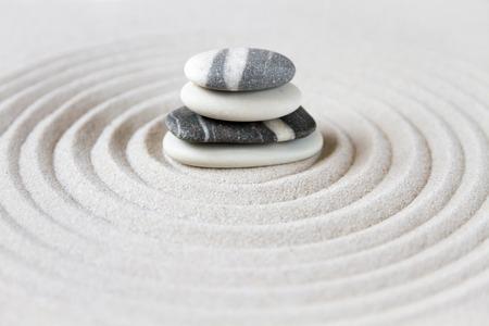 Black and white stones in the sand. Zen japanese garden background scene