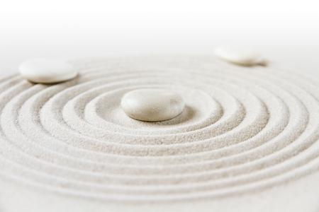 White stones in the sand. Zen japanese garden background scene