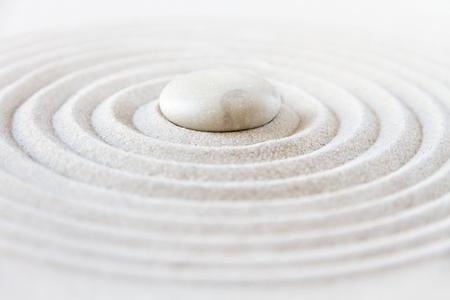 White stone in the sand. Zen japanese garden background scene Фото со стока