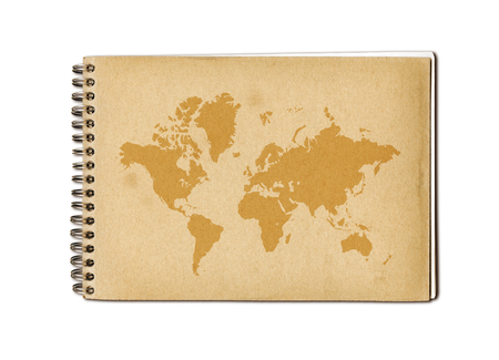 Vintage world map printed on an old notebook cover Reklamní fotografie