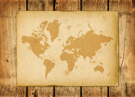 Antique vintage world map parchment on a wooden wall Archivio Fotografico - 123340042