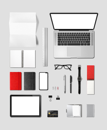 Office desk branding mockup top view isolated on grey. Blank space Stock Photo