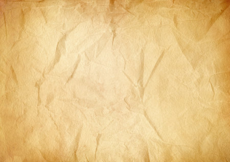 Old brown crumpled paper texture background. Vintage wallpaper