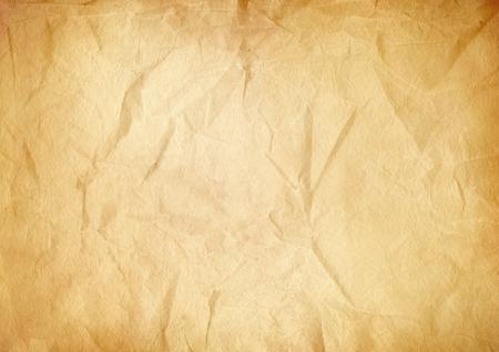 Oud bruin verfrommeld papier textuur achtergrond. Vintage behang Stockfoto