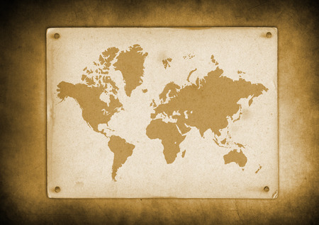 Antique vintage world map parchment nailed to a wall Archivio Fotografico - 124988789