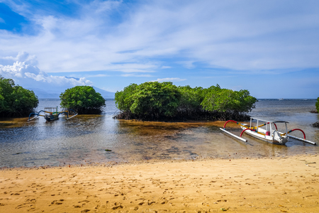 Mangrove beach and traditional boat in Nusa Lembongan island, Bali, Indonesia