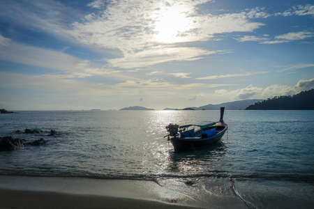 Tropical beach and boat at sunset in Koh Lipe, Thailand