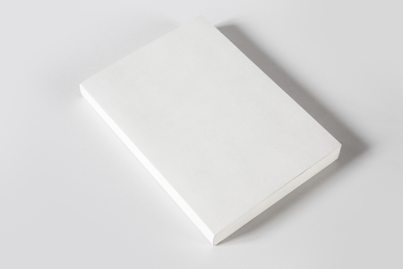 Closed blank book mockup, isolated on grey