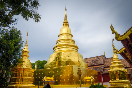 Wat Phra Singh golden stupa in Chiang Mai, Thailand Stock fotó - 124989010