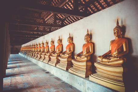Gold Buddha statues in Wat Phutthaisawan temple, Ayutthaya, Thailand Stock fotó - 124989034