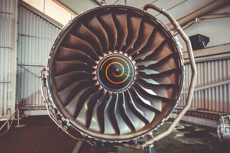 Airplane engine maintenance in airport hangar. Closeup view Imagens