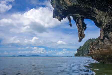 Kayak boat in Phang Nga Bay limestone cliffs, Thailand