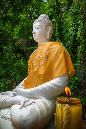 White Buddha statue in jungle, Wat Palad, Chiang Mai, Thailand