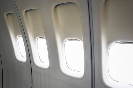 Blank airplane windows in a commercial flight cabin