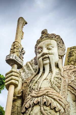 Chinese Guard statue in Wat Pho Buddhist temple, Bangkok, Thailand