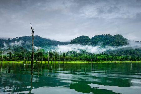 Misty morning on Cheow Lan Lake in Khao Sok National Park, Thailand