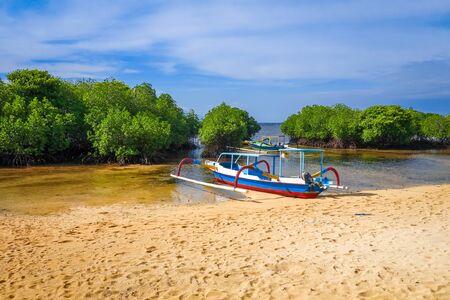 Mangrove beach and traditional boat in Nusa Lembongan island, Bali, Indonesia